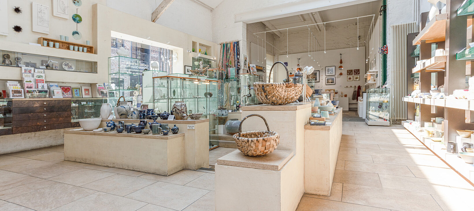 Image displays the interior of Bluecoat Display Centre shop, with shelves of various gifts.