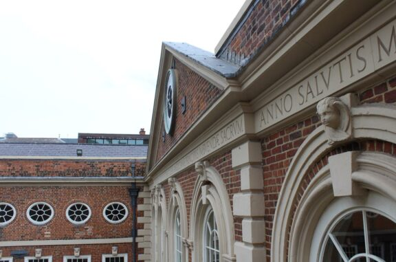 Latin inscription on the front of the building