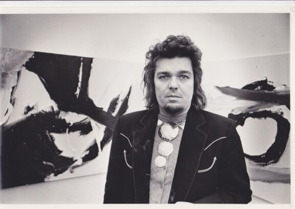 Captain Beefheart in the Bluecoat gallery in front of his paintings