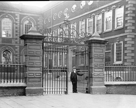 School boy at front gates