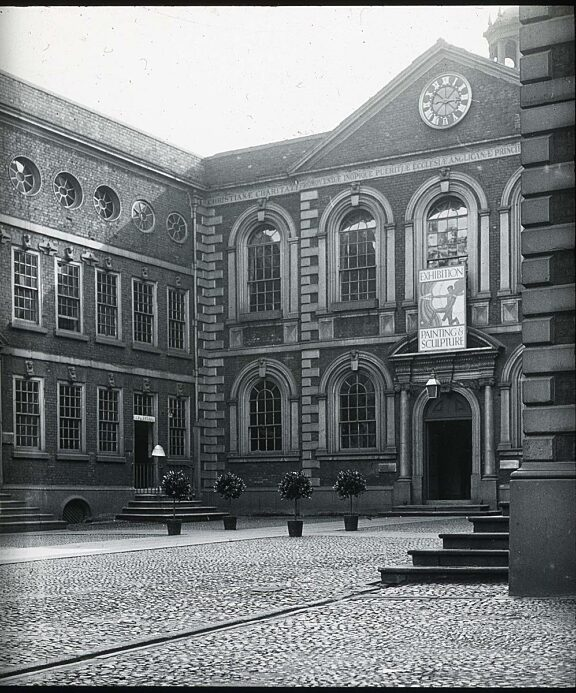 Bluecoat with sign advertising a modern art exhibition