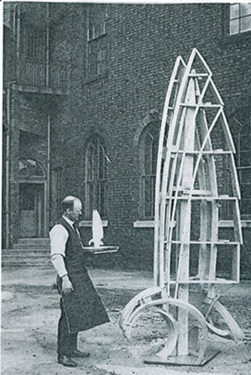 Artist in the Bluecoat yard, holding a maquette for a traffic pylon sculpture